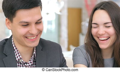 Close-up of face, young attractive analytic couple consults...