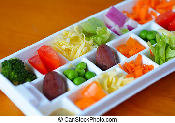 Fresh vegetables served in small portions tray