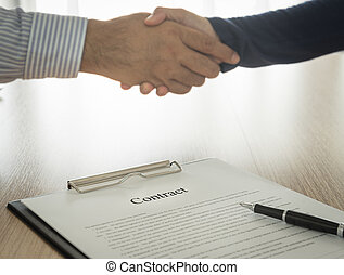 contract - Documents contracting with partners are handshake...