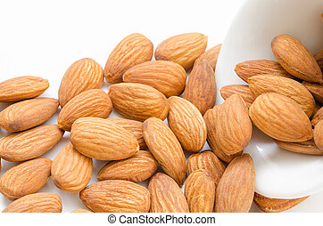 Almond in white bowl.