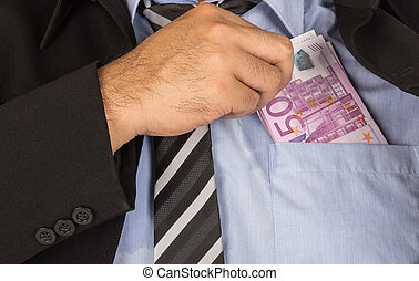 corrupt - Businessman a putting money in his pocket