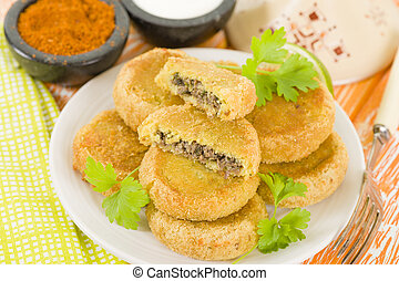 Batata Chap - Middle Eastern potato croquette filled with...