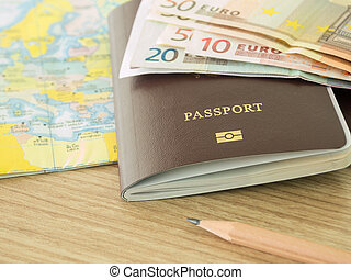 travels - closeup passport on world map with banknote