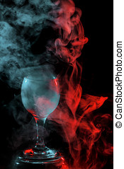Red and blue smoke in a glass. Halloween. - Abstract art....