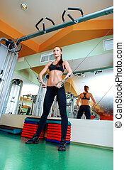 endurance - Athletic young woman is training arm and...