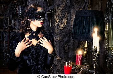 female vampire - Charming mysterious girl in black mask and...