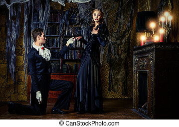vampire love - Beautiful man and woman vampires dressed in...