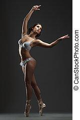 Erotic dance. Sensual ballerina dancing at camera - Erotic...