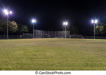 Empty baseball field at night with the lights on - Night...