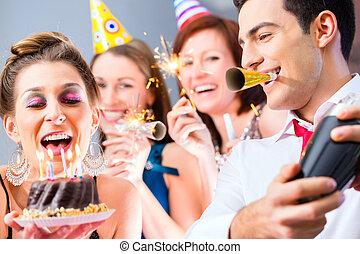 Friends having  birthday celebration