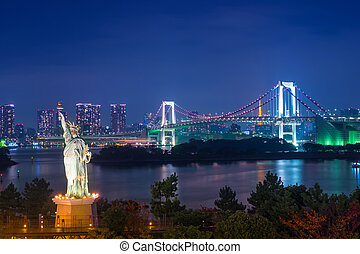 Statue of Liberty and Rainbow bridge at Odaiba Tokyo in twilight