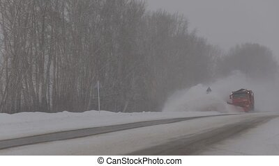Clearing the road from snow , snow removal bucket