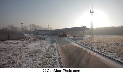 Trucks at gas pump station off highway