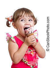 joyful child girl eating ice cream in studio isolated -...