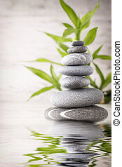 Spa stones. - Spa stones on the grey background.