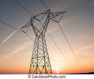 Electric lines silhouetted by a sunset - Electric power...