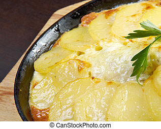 sea bass in tagineBaked potatoes with sour cream