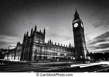 Red bus, Big Ben and Westminster Palace in London, the UK. at night. Black and white
