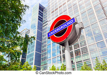 Underground sign in Canary Wharf financial district in London, UK.