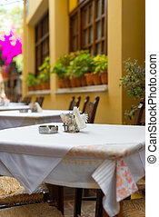 Mediterranean restaurant terrace exterior with chairs.