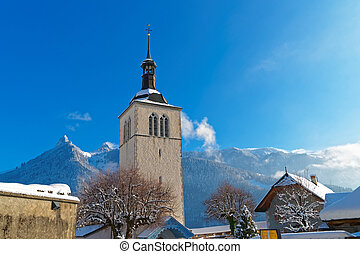 Saint Theodule church and Alps mountains in the background