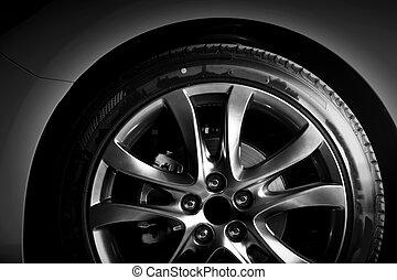Close-up of aluminium rim of luxury car wheel. Detail...
