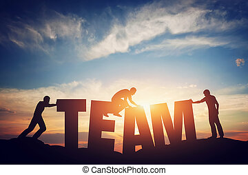 People connect letters to compose the team word. Teamwork...