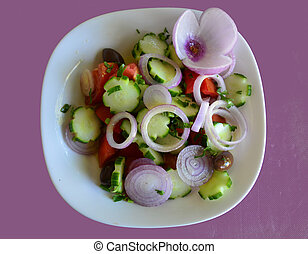 Food - Greek salad with cucumber,onions and red pepper on...