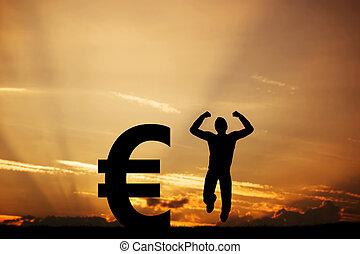Man jumping for joy next to EURO symbol. Winner - Happy man...