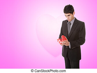 handsome young man in suit with heart - a handsome young man...
