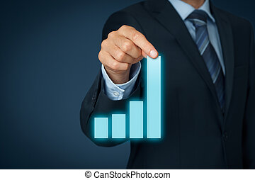 Business in progress - Businessman pull column of graph to...