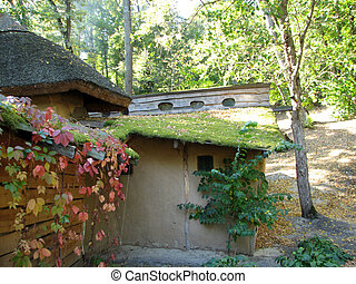 The old adobe house with a thatched roof in a beautiful...