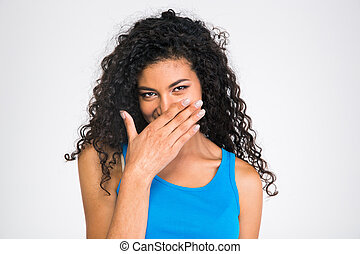 Happy afro american woman covering her mouth