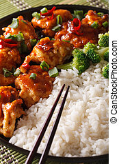 Asian Chicken tso with rice and broccoli close-up. vertical...