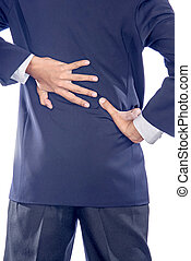 Backache concept bending over in pain with hands holding...