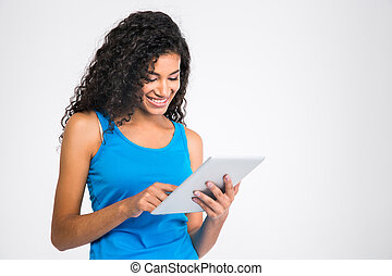 Smiling afro american woman using tablet computer - Portrait...