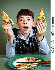 boy with pizza plate on blue background - happy preteen boy...