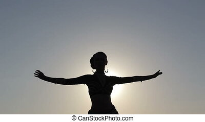Silhouette girl dancing exotic dance
