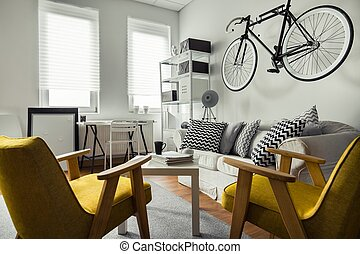 Bicycle hanging on the wall in living room