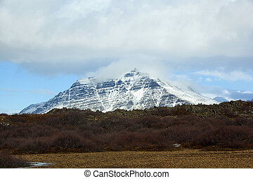Snowy volcanic landscape on the Snaefellsnes peninsula -...