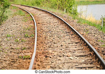 detail of an old railway that runs along a lake in the...