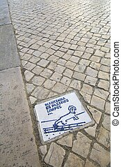 banned dogs urinate - ceramic plate in a cobblestone...