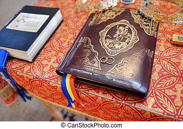 Wedding rings on prayer book in Orthodox church