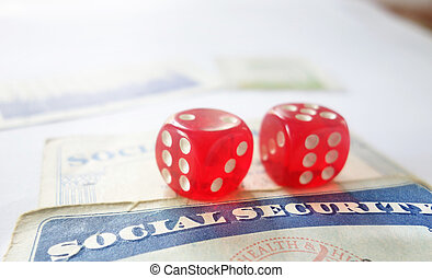 Dice and cards - Red dice and US Social Security cards...