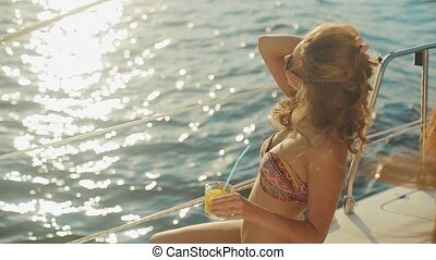 Girl model relaxing on a yacht. Rest on the water. Journey...