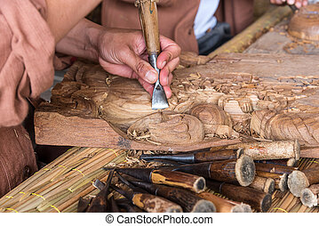 Craftsman wooden carving. - Hands of the craftsman wooden...