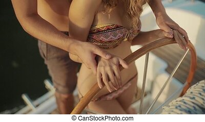 Guy teaches the girl of yachting.