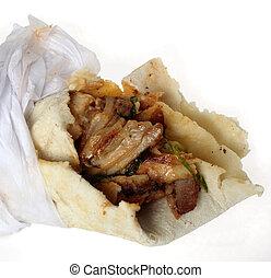 Arab shawarma close-up - Close-up view of an Arab chicken...