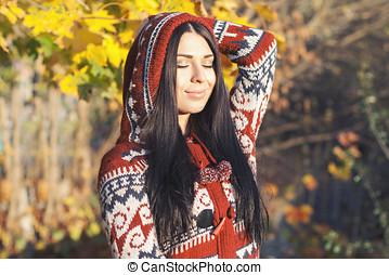 Beautiful woman in autumn