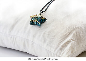 Necklace metal crystals stars colorful on backrest pillow...